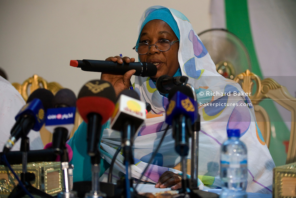 A lady delivers a speech during the first-ever international Conference on Womens' Challenge in Darfur, gather in a compound belonging to the Govenor of North Darfur in Al Fasher (also spelled, Al-Fashir) Sudan where the women from remote parts of Sudan gathered to discuss peace and political issues.