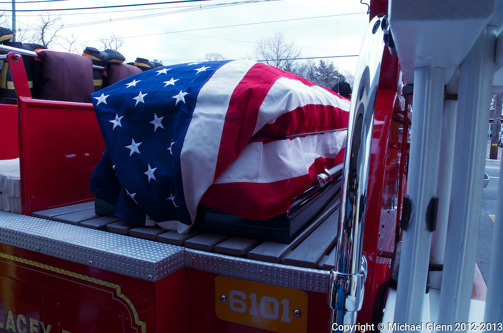 Casket bearing Daniel Ingls Jr. on the back of LHFD engine 6101