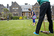 Playing croquet in the garden at Pickwell Manor. From left to right: Molly Elliott (10), Milly-grace (8),  Liza Baker (9), Zac Baker (11). Pickwell Manor, Georgeham, North Devon, UK.<br /> CREDIT: Vanessa Berberian for The Wall Street Journal<br /> HOUSESHARE