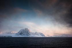 Svalbard mountains in Smeerenburgfjorden in March at the northern tip of Spitsbergen, Svalbard, Norway