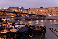France. Paris. 1st district . Art bridge on the Seine river , Louvre museum  / le pont des arts sur la Seine