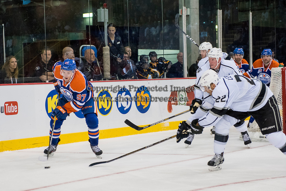 KELOWNA, CANADA - OCTOBER 2: Connor McDavid #97 of the Edmonton Oilers back hands the puck against Los Angeles Kings on October 2, 2016 at Kal Tire Place in Vernon, British Columbia, Canada.  (Photo by Marissa Baecker/Shoot the Breeze)  *** Local Caption *** Connor McDavid;