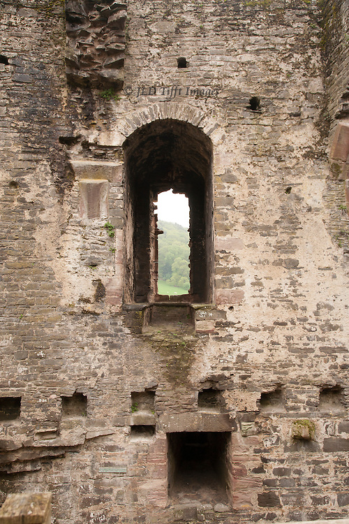 Views of the ruins of Conwy Castle, Conwy, Wales. Tower interior with arched window and holes for floor beams.