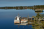 View of inlet on Bush Island near with moored fishing boat Crescent Beach, Nova Scotia, Canada,