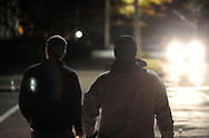 EDITORS PLEASE NOTE: WE WERE ONLY ALLOWED TO IDENTIFY AND SHOW FACES ON THREE OF THE MONITORS AND NOT ALLOWED TO IDENTIFY FRATERNITIES BY NAME: Party monitors walk the streets as they check in on fraternities and sororities at Penn State University Sunday, November 12, 2017 in State College, Pennsylvania. (Photo by William Thomas Cain/CAIN IMAGES)