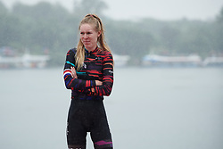 Hannah Barnes (GBR) waits on the podium in the pouring rain at GREE Tour of Guangxi Women's World Tour 2018, a 145.8 km road race in Guilin, China on October 21, 2018. Photo by Sean Robinson/velofocus.com