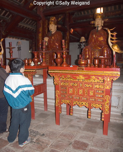 statues of Confucious' discilples; altar tables; red & gold; ornate; people praying, House of Ceremonies; Temple of Literature; Hanoi; Vietnam