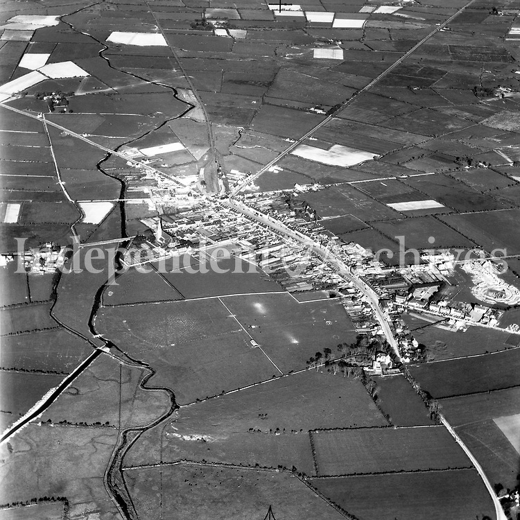 A96 Castleisland.   25/09/53 (Part of the Independent Newspapers Ireland/NLI collection.)<br /> <br /> <br /> These aerial views of Ireland from the Morgan Collection were taken during the mid-1950's, comprising medium and low altitude black-and-white birds-eye views of places and events, many of which were commissioned by clients. From 1951 to 1958 a different aerial picture was published each Friday in the Irish Independent in a series called, 'Views from the Air'.<br /> The photographer was Alexander 'Monkey' Campbell Morgan (1919-1958). Born in London and part of the Royal Artillery Air Corps, on leaving the army he started Aerophotos in Ireland. He was killed when, on business, his plane crashed flying from Shannon.