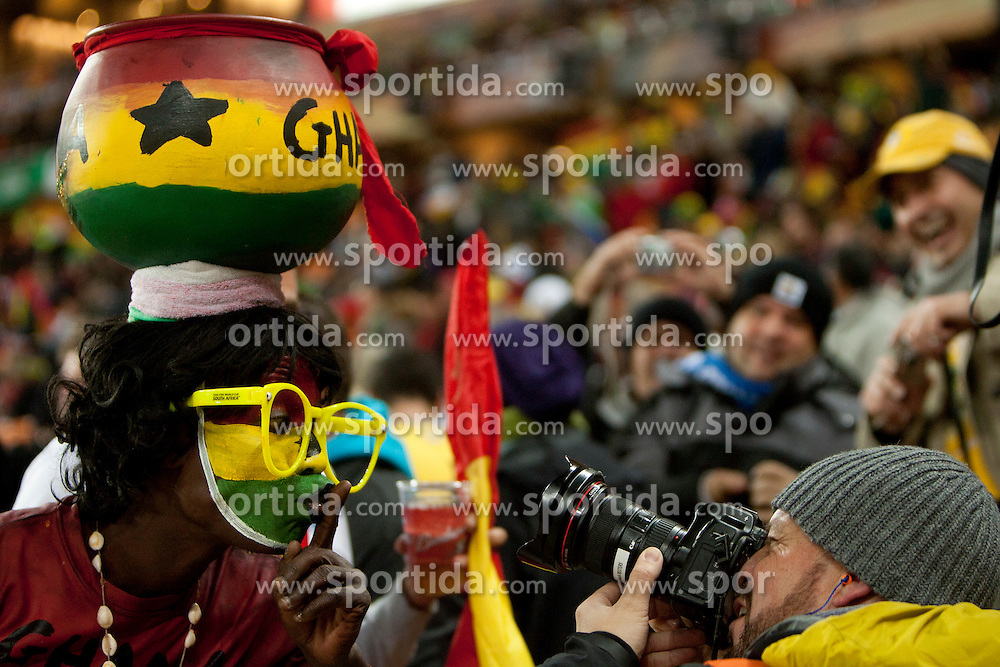A photographer taking close up picture of Fan of Ghana prior to the 2010 FIFA World Cup South Africa Quarter Finals football match between Uruguay and Ghana on July 02, 2010 at Soccer City Stadium in Sowetto, suburb of Johannesburg. Uruguay defeated Ghana after penalty shots. (Photo by Vid Ponikvar / Sportida)