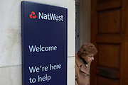 A customer walks out of  Natwest bank , Baker street, London.