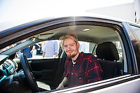 Kyle Bigler sits behind the wheel of his 2005 Honda Accord from AutoServe of Tilton on Tuesday morning.  (Karen Bobotas/for the Laconia Daily Sun)