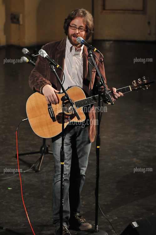 Jonathan Coulton about to strum something, at the Woolsey Hall Concert, Century on a Spree: The Whiffenpoof Centennial (1909-2009)