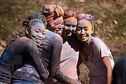 Friends Tshepi Mogwera, Kombe Kapatamoyo Jr. Emma Bryce and Vicki Wijaya pose for a photograph during the Holi Festival of Color organized by Ohio University's Indian Students Association Saturday March 15, 2014.  Photo by Ohio University / Jonathan Adams