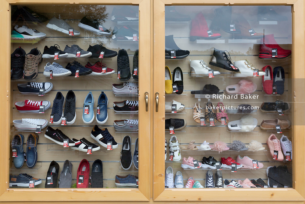 A detail of a Polish shoe shop window display, on 16th September 2019, in Zakopane, Malopolska, Poland.