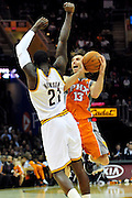 Jan. 19, 2011; Cleveland, OH, USA; Cleveland Cavaliers power forward J.J. Hickson (21) fouls Phoenix Suns point guard Steve Nash (13) during the fourth quarter at Quicken Loans Arena. The Suns beat the Cavaliers 106-98. Mandatory Credit: Jason Miller-US PRESSWIRE