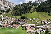 The beautiful ski resort of Selva di Val Gardena (German: Wolkenstein in Gröden; Ladin: Sëlva Gherdëine) makes a great hiking base in the Dolomites, in the South Tyrol region (Trentino-Alto Adige/Südtirol) of Italy, Europe. For our favorite hike in the Dolomiti, start from Selva with the first morning bus to Ortisei, take the Seceda lift, admire great views up at the cross on the edge of Val di Funes (Villnöss), then walk 12 miles (2000 feet up, 5000 feet down) via the steep pass Furcela Forces De Sieles (Forcella Forces de Sielles) to beautiful Vallunga (trail #2 to 16), finishing where you started in Selva. The hike traverses the Geisler/Odle and Puez Groups from verdant pastures to alpine wonders, all preserved in a vast Nature Park: Parco Naturale Puez-Odle (German: Naturpark Puez-Geisler; Ladin: Parch Natural Pöz-Odles). UNESCO honored the Dolomites as a natural World Heritage Site in 2009.