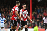 Brentford forward Sergi Canos (7) celebrates after scoring their third goal to make it 3-0*** during the EFL Sky Bet Championship match between Brentford and Queens Park Rangers at Griffin Park, London, England on 2 March 2019.