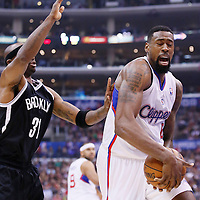 16 November 2013: Los Angeles Clippers center DeAndre Jordan (6) grabs a rebound during the Los Angeles Clippers 110-103 victory over the Brooklyn Nets at the Staples Center, Los Angeles, California, USA.
