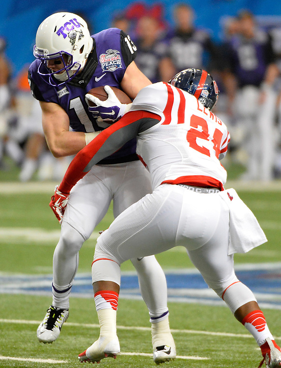 Mississippi Rebels linebacker Keith Lewis (24) stops TCU Horned Frogs wide receiver Ty Slanina (13) in the first half of the Ole Miss vs. TCU Chick-fil-A Peach Bowl football game at the Georgia Dome on December 31, 2014. David Tulis / Abell Images for the Chick-fil-A Bowl