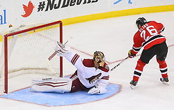 Mar 27, 2014; Newark, NJ, USA; Phoenix Coyotes goalie Thomas Greiss (1) makes a save on New Jersey Devils left wing Patrik Elias (26) to win the shootout at Prudential Center. The Coyotes defeated the Devils 3-2 in a shootout.