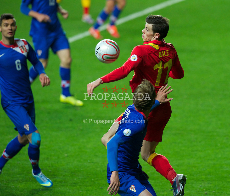SWANSEA, WALES - Tuesday, March 26, 2013: Wales' Gareth Bale in action against Croatia during the 2014 FIFA World Cup Brazil Qualifying Group A match at the Liberty Stadium. (Pic by Tom Hevezi/Propaganda)