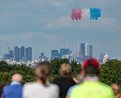 © Licensed to London News Pictures. 18/06/2020. London, UK. Huge crowds gathered in Richmond Park, South West London today to watch the Red Arrows and the French Patrouille de France flying over the park releasing smoke in the colours of the French flag as they head to central London to mark Emmanuel Macron's visit to the UKfor the 80th anniversary of Charles de Gaulle's rallying cry to resist the Nazis. Photo credit: Alex Lentati/LNP