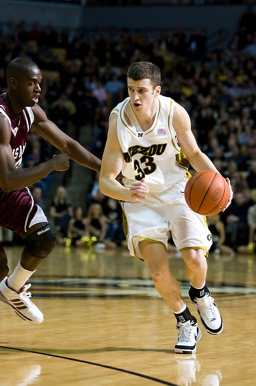 February 9th, 2008 - Columbia, MO.Texas A&M's Derrick Roland #3 tries to guard Missouri's Matt Lawrence #33 as he drives down the court at Mizzou Arena in Columbia, Missouri..Texas A&M defeated Missouri 77-69..Patrick T. Fallon / CSM