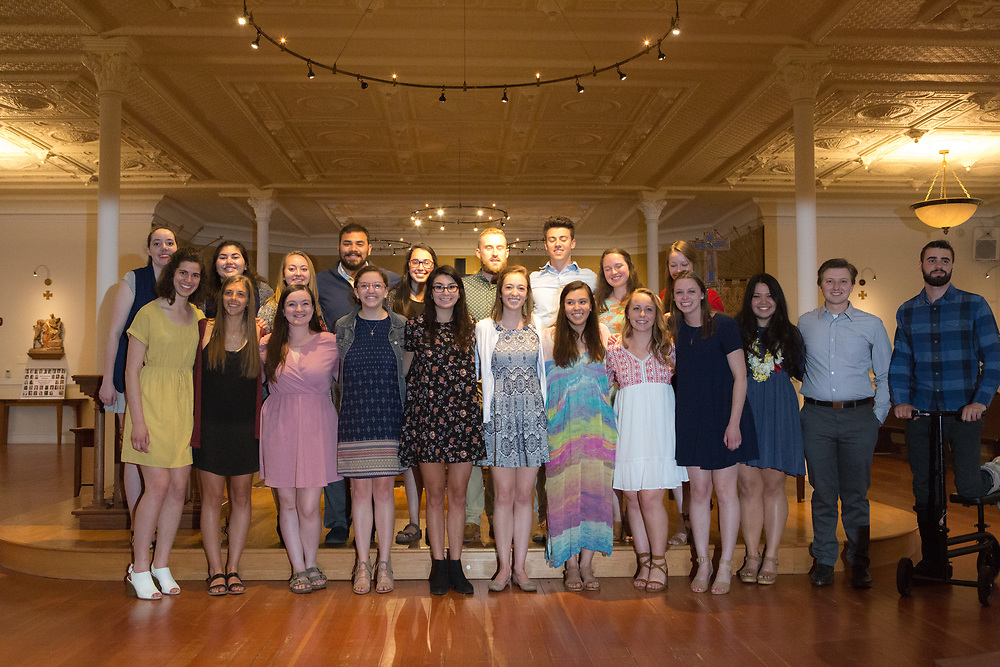 Graduates of the 2017 social justice missioning ceremony pose for a picture on May 12. The event took place in the Student Chapel in College Hall, led by keynote speaker Tyler Hobbs, and included the official pinning for senior social justice students.<br />