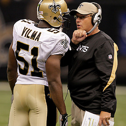 2009 September 13: New Orleans Saints defensive coordinator Gregg Williams talks to linebacker Jonathan Vilma (51) during a 45-27 win by the New Orleans Saints over the Detroit Lions at the Louisiana Superdome in New Orleans, Louisiana.
