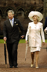 File photo dated 01/06/04 of the Prince of Wales arriving with the Duchess of Cornwall, then Camilla Parker-Bowles, for a garden party at the Palace of Holyroodhouse in Edinburgh.