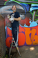 "Huntington, New York, U.S. 24th August 2013. SONIC BAD, legendary street artist JESSE RODRIGUEZ from the Bronx, is on a step ladder graffiti painting the ""Art Matters"" wall, on the back of the Huntington Arts Council building, during the the art event ""Off the Walls"" Block Party, by SPARKBOOM, a project the council created to help emerging artists, showcase talents, and help its artistic family network."