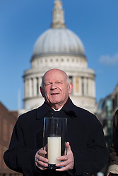 © licensed to London News Pictures. London, UK 27/01/2013. Ben Helfgott, a Holocaust survivor holding a candle to mark Holocaust Memorial Day on Millennium Bridge in London. Photo credit: Tolga Akmen/LNP