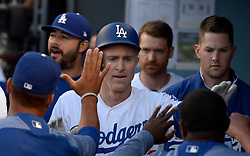 June 10, 2017 - Los Angeles, California, U.S. - Los Angeles Dodgers' Chase Utley high fives teammates after scoring on a RBI double by teammate Corey Seager (not pictured) against the Cincinnati Reds in the first inning of a Major League baseball game at Dodger Stadium on Saturday, June 10, 2017 in Los Angeles. (Photo by Keith Birmingham, Pasadena Star-News/SCNG) (Credit Image: © San Gabriel Valley Tribune via ZUMA Wire)