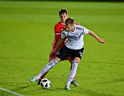 WREXHAM, WALES - Tuesday, September 10, 2019: Wales' Liam Cullen (L) and Germany's Nico Schlotterbeck during the UEFA Under-21 Championship Italy 2019 Qualifying Group 9 match between Wales and Germany at the Racecourse Ground. (Pic by David Rawcliffe/Propaganda)