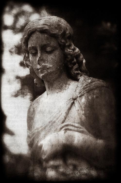 A female statue in cemetery