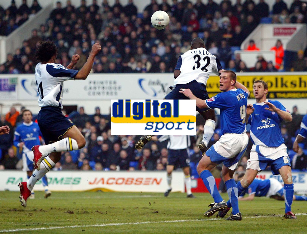 Photo: Chris Ratcliffe.<br />Ipswich Town v Portsmouth. The FA Cup. 07/01/2006.<br />Dario Silva (L) rises to head the first Portsmouth goal after it clears Jason De Vos (R) and Lomana Lua Lua.