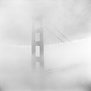 Fog shrouds the North tower of San Francisco's Golden Gate Bridge