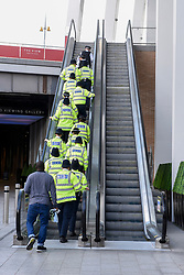 © Licensed to London News Pictures. 04/06/2017. London, UK. A group of policemen walk up the stairs near The Shard.  Police cordons continue to be in place around London Bridge after the previous night's terrorist attack where a reported three attackers were shot by the police and seven members of the public died after being attacked with knives.  Photo credit : Stephen Chung/LNP