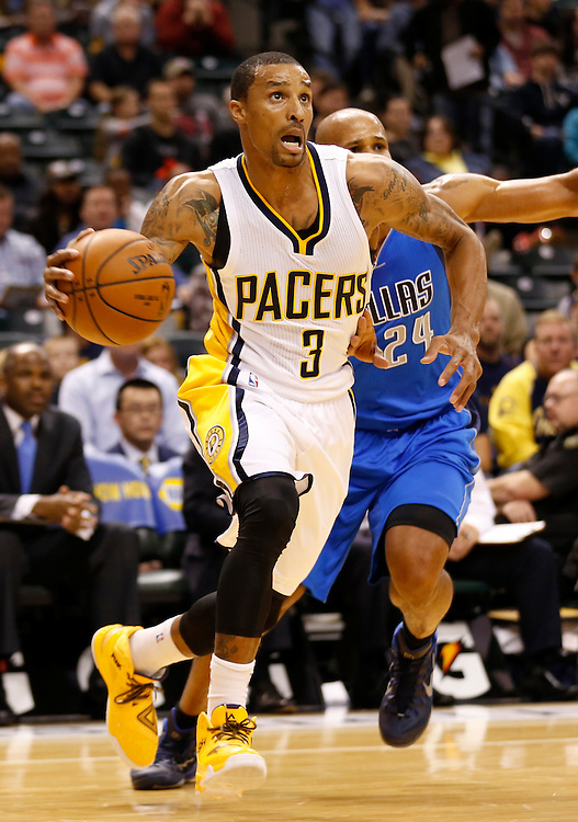 Indiana Pacers' George Hill moves toward the basket against the Dallas Mavericks at Bankers Life Fieldhouse Saturday October 18, 2014.