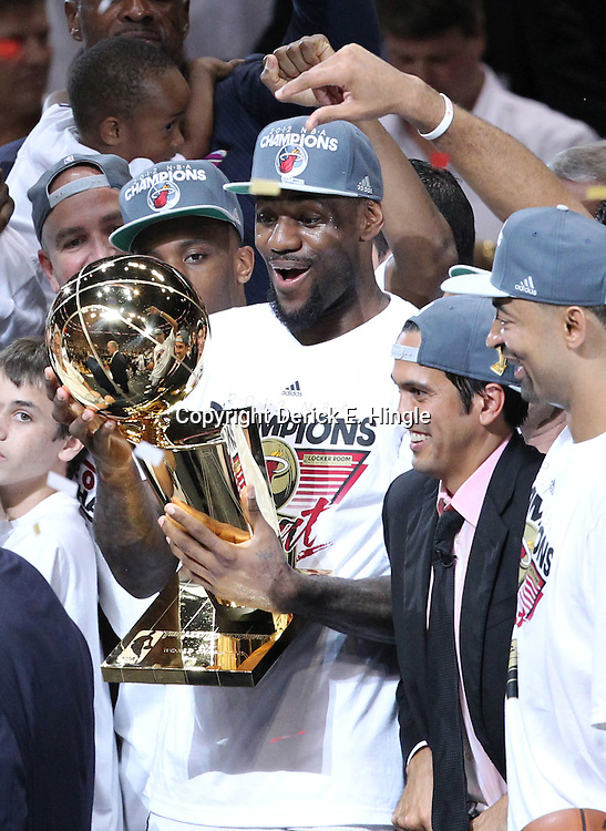 Jun 21, 2012; Miami, FL, USA; Miami Heat small forward LeBron James (6) holds up the Larry O'Brien Trophy after winning the 2012 NBA championship at the American Airlines Arena. Miami won 121-106. Mandatory Credit: Derick E. Hingle-US PRESSWIRE