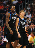 Apr. 11, 2011; Phoenix, AZ, USA; Minnesota Timberwolves guard Martell Webster (5) walks with teammate guard Luke Ridnour (13) while playing against the Phoenix Suns at the US Airways Center. The Suns defeated the Timberwolves 135 -127 in overtime. Mandatory Credit: Jennifer Stewart-US PRESSWIRE