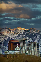 Downtown Salt Lake City at sunset with the snow-capped Wasatch Mountains in the background.