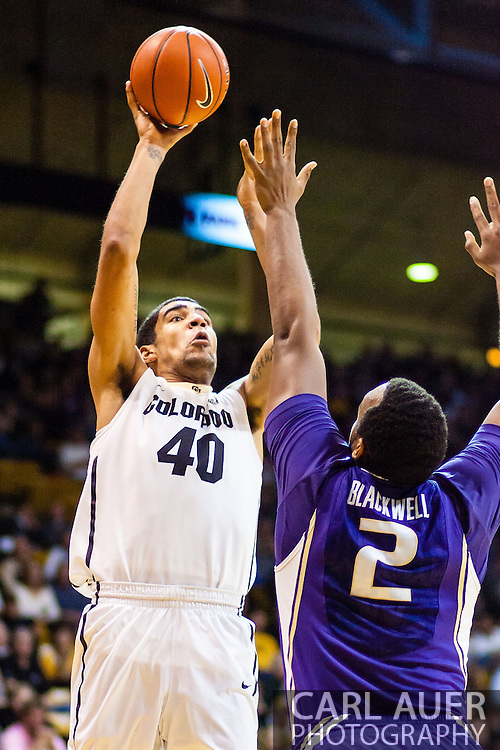 February 9th, 2014:  Colorado Buffaloes sophomore forward Josh Scott (40) attempts a shot over Washington Huskies senior forward Perris Blackwell (2) in the second half of the NCAA Basketball game between the Washington Huskies and the University of Colorado Buffaloes at the Coors Events Center in Boulder, Colorado