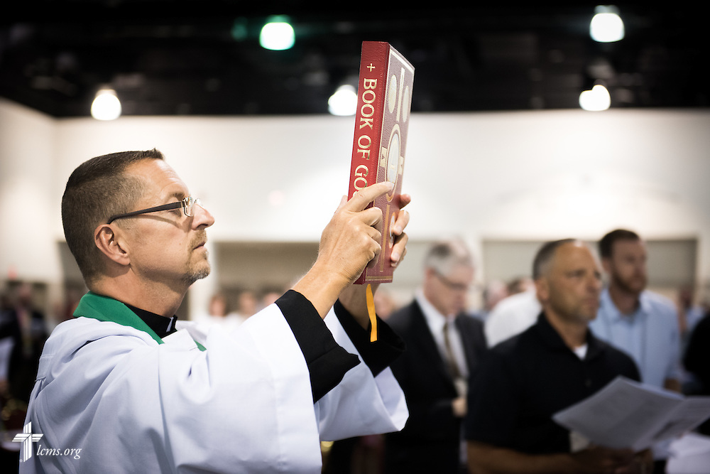 The Rev. Will Weedon, chaplain of the LCMS International Center, carries the Holy Gospel at the Opening Divine Service of the 66th Regular Convention of The Lutheran Church–Missouri Synod on Saturday, July 9, 2016, at the Wisconsin Center in Milwaukee. LCMS/Erik M. Lunsford