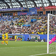 GRENOBLE, FRANCE June 18.  Sam Kerr #20 of Australia scores the first of her four goals beating defended Chantelle Swaby #4 of Jamaica an goalkeeper Nicole McClure #13 of Jamaica during the Jamaica V Australia, Group C match at the FIFA Women's World Cup at Stade des Alpes on June 18th 2019 in Grenoble, France. (Photo by Tim Clayton/Corbis via Getty Images)