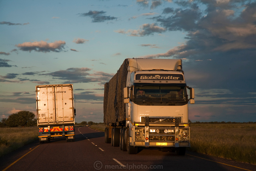 Haulage trucks on the Trans-Kalahari highway near the city of Ghanzi, Botswana.