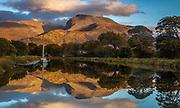 Yacht reflection  in canal, autumn on Ben Nevis, highest peak in Scotland & United Kingdom, The Highlands, Scotland.