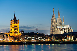 Evening view of skyline of Cologne and the cathedral beside River Rhine in Germany