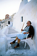 Greece, Cyclades, Santorini, (Thira), elderly woman in village of Oia