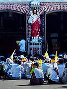 30 NOVEMBER 2017 - YANGON, MYANMAR: People on the grounds of the cathedral sit on the pavement during the Papal Mass at St. Mary's Cathedral in Yangon. Thursday's mass was his last public appearance in Myanmar. From Myanmar the Pope went on to neighboring Bangladesh.    PHOTO BY JACK KURTZ